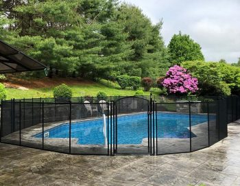 black mesh pool fence installed in Armonk, NY