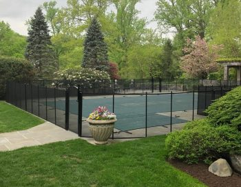 black mesh pool fence with self-latching and self-closing gate in Pleasantville, NY