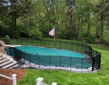 Custom shaped mesh pool fencing installed in Madison, CT